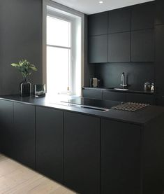 Not often that your see an all black kitchen. Contemporary