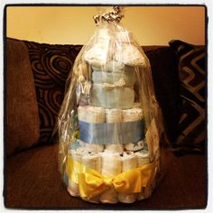 Little Boy's nappy cake  3 tiers of nappies, babygrows, booties, toiletries and toys. All cello wrapped and pretty!!!
