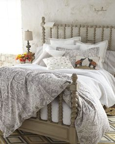 Gray and white bedding. Needs red accents
