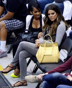 Khloe with her light yellow Celine handbag