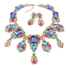 "Exquisite huge bib rhinestone set designed with five long dangling parts. Length of necklace 16.00"" and extension 2.50"", center part hangs 4.25"", earrings with clips 2.20"""