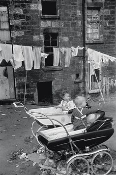 Untitled [two children in prams with washing on a line]