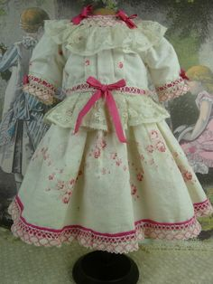 SWEET FLOWERED FRENCH ANTIQUE DOLLS DRESS WITH PINK DETAILS from Stairway To The Past at Ruby Lane
