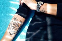 Stylish geometric bear tattoo on the forearm