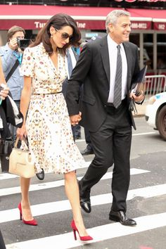 Amal Clooney out with hubby George Clooney wearing this pretty printed dress.