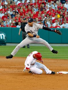 ~~Derek Jeter leaps over Jeff Mathis to complete a double play by day1953~~