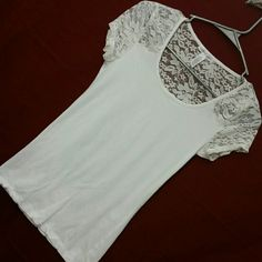 SHIRT White stretch lace short sleeve shirt. 95 cotton, 5 spandex. States med, I believe it could also fit small. Due to stretch, it would b the med that it states. Tops Tees - Short Sleeve