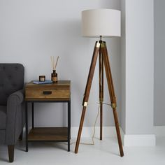 Add a modern, retro feel to your home with this tripod floor lamp. Designed with a simple, chunky leg look, this lamp has a natural varnished wood and a natural beige shade, suitable for a variety of living spaces. Wooden Tripod Floor Lamp, Wood Floor Lamp, Tripod Lamp, Diy Floor Lamp, Natural Floor Lamps, Natural Wood Flooring, Antique Brass Floor Lamp, Rustic Floor Lamps, Houses