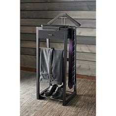 Kenneth Cole Reaction® Standing Valet.  This might help wrangle him laying out his clothes for tomorrow all over the place.