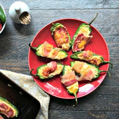 Bacon Wrapped Stuffed Jalapeños - These bacon wrapped cheese stuffed jalapeños are a delicious low carb appetizer or snack. So easy to make and you can even freeze them and cook later.