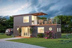Great shipping container house built with a 40 and 20 foot containers on two levels with deck