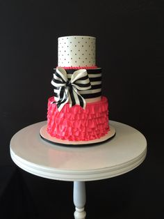 Hot pink ruffles, black and white stripes cake