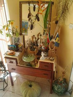 My Osun Shrine with pumpkin I picked from my garden today , and my current line of Egyptian cotton painted sheets : NYAME DUA : tree of God / Gods protection and presence . Comfort line not done yet just sharing the love. Maferefun Oshun .ase