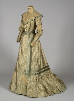 1900-10 Four-piece reception dress comprised of changeable blue-green taffeta printed with paisley motifs