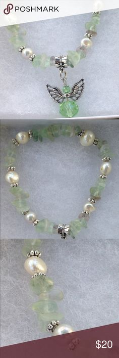 "Multicolor Flourite and Pearl Angel Bracelet This beautiful bracelet is made with natural multicolor fluorite and cultured freshwater pearls. The fluorite is mostly green with tiny hints of purple. The accents are natural freshwater pearls, and the glass angel charm adds a cute touch! This piece is on elastic and will stretch to fit up to a 7.5"" wrist.   All PeaceFrog jewelry items are handmade by me! Let me know if you need the size adjusted. Take a look through my boutique for more unique…"