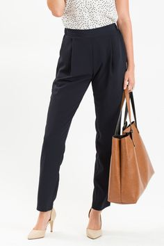 When your work pants are so comfy that you wear them even on the weekends, that's when you know you have a closet staple! These flowy pants come in a dark navy color that can be dressed up or down for