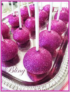 cake pops dipped in pink icing and edible glitter!
