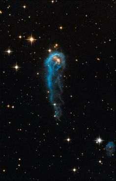 ♥ 'Space Caterpillar' Seen By Hubble Telescope Is 6 Trillion Miles Long