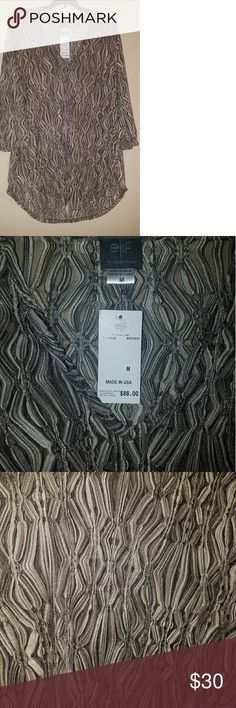 "Elf for Jordan Taylor Bathing Suit Cover sM MSRP - $88.00   Material - 85% Polyester 12% Nylon 3% Spandex   Measurements       Front Length - 31""       Neck Length - 32""       Chest - 17"" Elf for Jordan Taylor Swim Coverups"