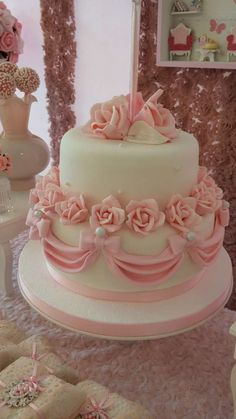 Rose covered cake at a shabby chic birthday party! See more party planning ideas at CatchMyParty.com!
