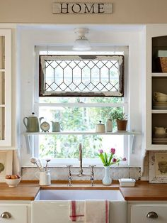Want a shelf over the sink and in front of window like this.  LOVE apron sink, distressed backsplash and window feature