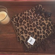 NWT cheetah coach neck scarf in camel Adorable scarf that will add a bit of spunk to any outfit! Can wear with a sweater or a leather jacket with jeans and boots!  I love to offer bundle discounts! No trades. Please use the offer button to submit offers! Coach Accessories Scarves & Wraps