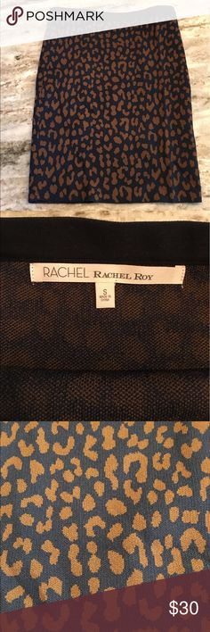 Rachael Roy Pencil Skirt Blue and brown leopard print Rachael Roy pencil skirt with black waistband. I am 5'6 and when worn at my natural waist it hits right above my knees - pretty long so definitely appropriate for work. Knit material - good for fall and winter. Never worn! Rachel Roy Skirts Pencil