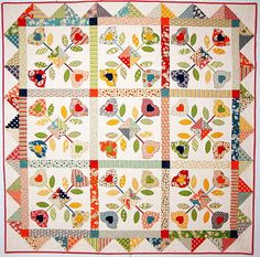 By Glenna from Hollyhock Quilts...   i LOVE this quilt, just not sure i can do all that applique,  i'm so slow at it.