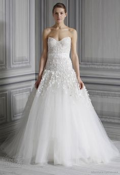 Aphrodite. Beautiful silk white embellished illusion tulle sweetheart neckline gown with embellished drop waist bodice highlighted with a floral sash.