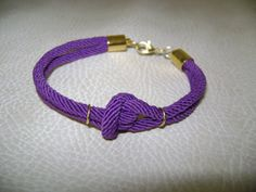 Purple cord bracelet with knot