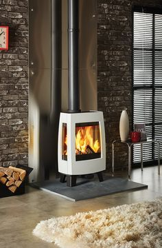 The Dovre Sense 113 wood burning stove has the signature ultra-contemporary styl. Gas Stove Fireplace, Brick Fireplace, Fireplace Design, Cast Iron Stove, Freestanding Fireplace, Curved Wood, Wood Burning Fires, Tiny House Cabin, Gas Logs