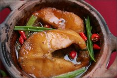 Fish braise with sauce ( Cá kho tộ ) is a food that poor people often cook for a long time but now aday, it becomes popular. The taste and smell attrative anyone who enjoy eat already. Not take a long time to cook and normal level.