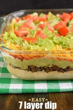 The Ultimate 7 Layer Dip recipeis packed with layers of Cream Cheese Sour Cream Ground Beef (and/or Beans) Guacamole Salsa Cheese and more! Layered Nacho Dip, Layered Taco Salads, Layered Bean Dip, Bean Dip Recipes, Cheese Dip Recipes, Meat Appetizers, Appetizer Recipes, Mexican Appetizers, Holiday Appetizers