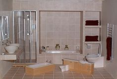 """https://flic.kr/p/5ocL75   Dollhouse bathrooms   Thought I'd show the contrast...a 1/24th (1/2"""") scale bathroom sitting in a 1/12th (1"""") scale one."""