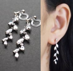 Dangle Bridal Leaf Cubic Zirconia Crystal Invisible Clip on Earrings by MiyabiGrace. These invisible clip on earrings are made from resin and comfortable to wear. You can wear them for straight 8 hours. And moreover, earring backs are clear, so they are look like pierced earrings. These magic like invisible clip on earrings are available at MiyabiGrace.  夾耳環, 夾式耳環, イヤリング, Non Pierced Earrings