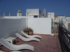 Suntrap and skyline on the second roof terrace, perfect for soaking up the hot African sun. Dar Qawi - Riad by te Sea in Essaouira, Morocco