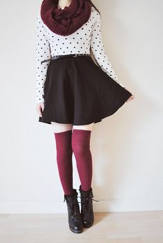 Cotton long-sleeved dotted t-shirt, flared black skirt, above the knee and maroon knee-high socks