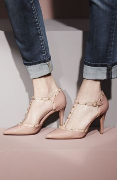 These nude studded T-strap pumps styled in glossy patent leather can be worn with practically anything!