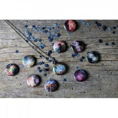 Interchangeable nebulae necklace with 10 designs - IFLScience Store!