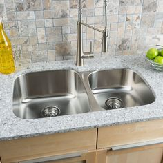 With elegant corner radiuses and a lustrous satin finish, the Classic 60/40 Double Bowl from Clark gives a timeless design element that complements any kitchen decor.
