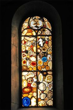 These unusual stained glass windows have been added to the Grossmünster cathedral in Zürich in 2009.  It was made with slices of agate, giving it a unique look and feel. There is a total of twelve windows created by Sigmar Polke.