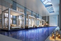 Swimming Pool:Residential Indoor Pool Ideas: Swimming In A Beauty Wonderful Enclosed Pool Designs Inspiration With Appealing Mosaic Sapphire Blue And Comfy Benches On Cubical Gazebo Also Beautify Elegant Candle Lanterns Feat Remarkable Skylight