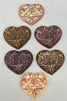 Hand painted solid chocolate hearts | Art Eatables | http://www.yelp.com/biz/art-eatables-louisville-3