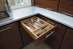 StarMark Cabinetry All-Wood Drawer Organizer. Re-arrange the dividers to fit your stuff.