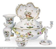 A GROUP OF HUNGARIAN TABLEWARES IN THE 'ROTHSCHILD BIRD' PATTERN,