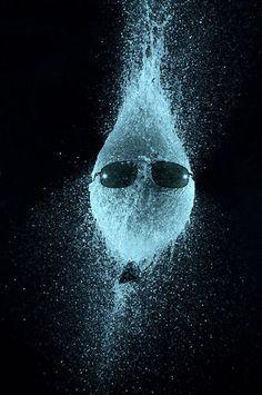 Scott Dickson's high-speed photographs capture water-filled balloons bursting