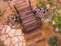 Sleepers, crazy pave Aussie sandstone, river rock dry creek bed and arid planting... love an Aussie garden concept.