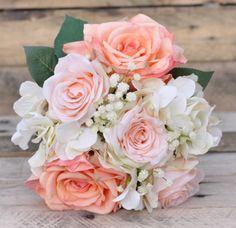 Peach, cream and coral with a touch of cream babies breath wedding bouquet. #destinationwedding #wedding #flowers Photography by Adair Design Haus. adairdesignhaus.com