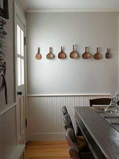 Love the wall paneling and the paddles hanging