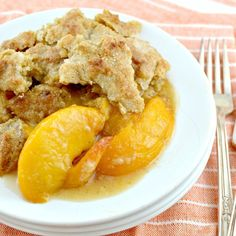 The Best Southern Peach Cobbler! Loaded with juicy,fresh peaches with just the right amount of spices,and the perfect cakey topping with crisp,sugary edges!